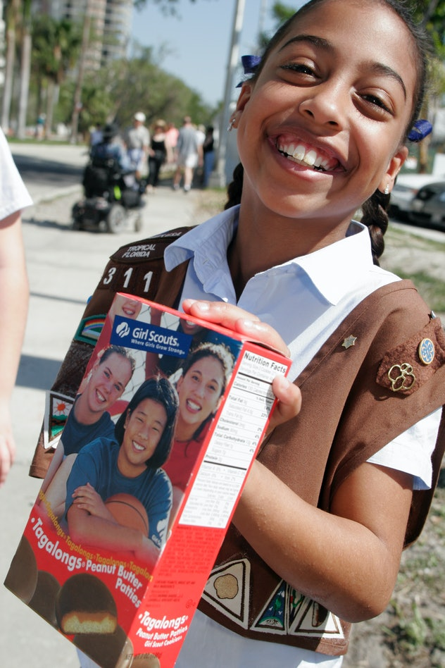 Girl Scout selling cookies.