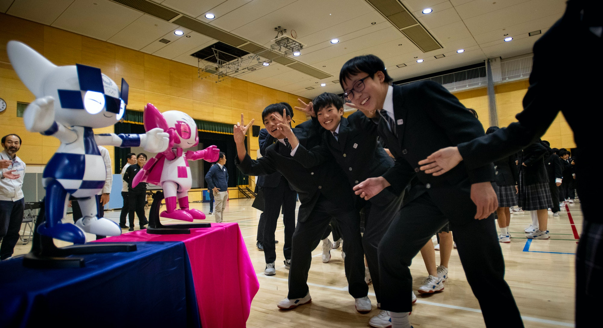 Schoolchildren interact with Tokyo 2020 Olympic and Paralympic Games' robot-type mascots Miraitowa a...