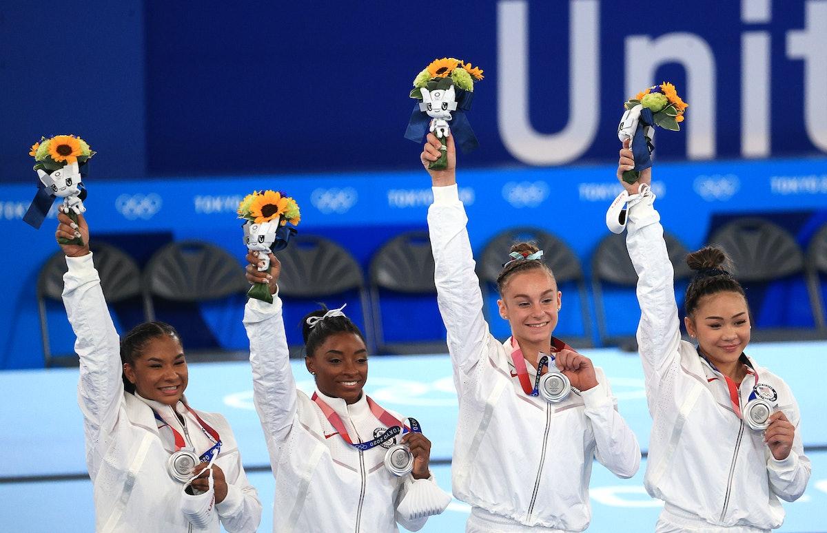 Silver medallists Simone Biles, Jordan Chiles, Grace McCallum, and Sunisa Lee (L-R) of the United St...