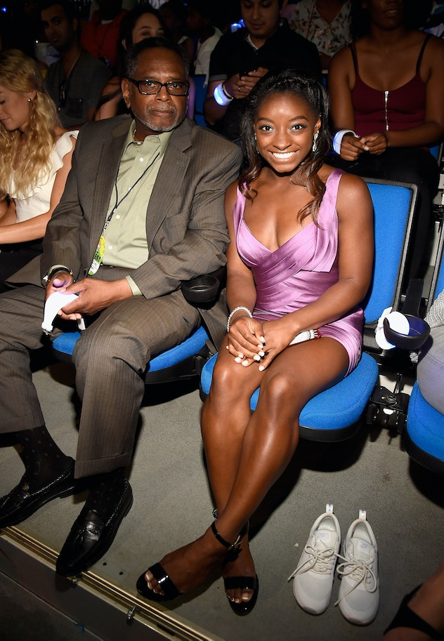LOS ANGELES, CA - JULY 13:  Olympic gymnast Simone Biles (R) and Ronald Biles attend Nickelodeon Kid...