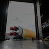 """This NASA photo released on January 6, 2020 shows NASAs powerful new rocket, the Space Launch System (SLS), which will send astronauts a quarter million miles from Earth to lunar orbit at the Michoud Assembly Facility in New Orleans, Louisiana. - The agency is committed to landing American astronauts, including the first woman and the next man, on the Moon by 2024. Through the agencys Artemis lunar exploration program, we will use innovative new technologies and systems to explore more of the Moon than ever before.On January 1, 2020, NASA Administrator Jim Bridenstine tweeted: """"Making progress! The massive @NASA_SLS core stage is moving to Building 110 at the Michoud Assembly Facility in Louisiana. There it will be readied for the Pegasus barge and its trip to @NASAStennis. Thank you to the @NASA team for working through the holidays!"""" (Photo by Jude Guidry / NASA / AFP) (Photo by JUDE GUIDRY/NASA/AFP via Getty Images)"""