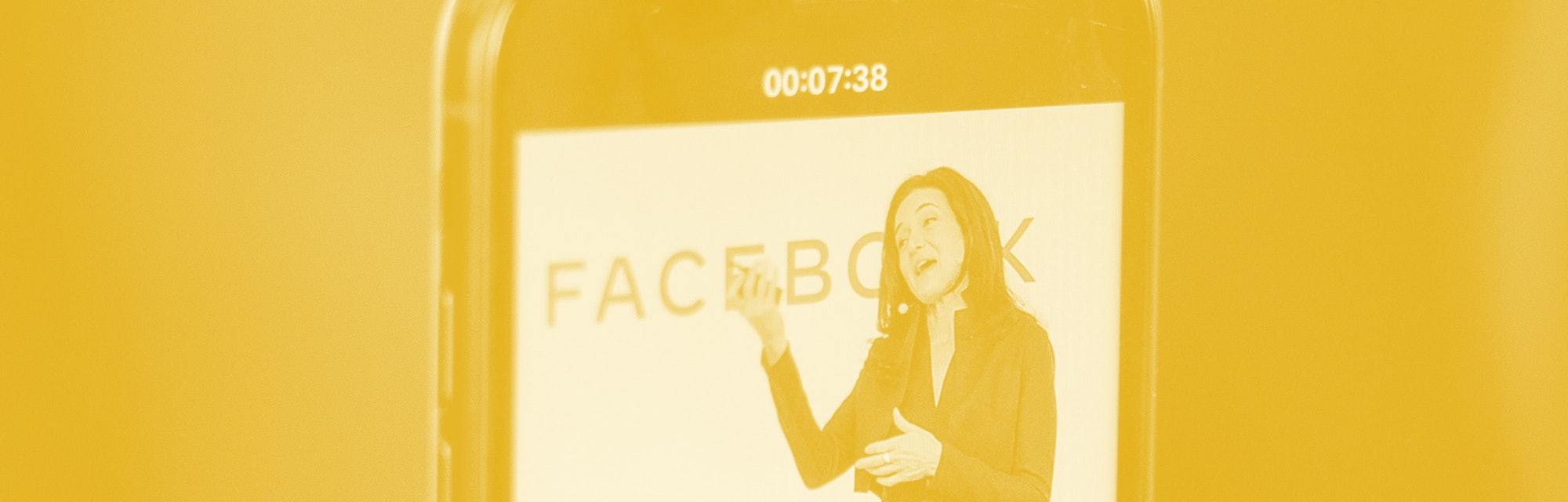 Facebook's Chief Operating Officer Sheryl Sandberg is displayed on the screen of a smartphone as she...