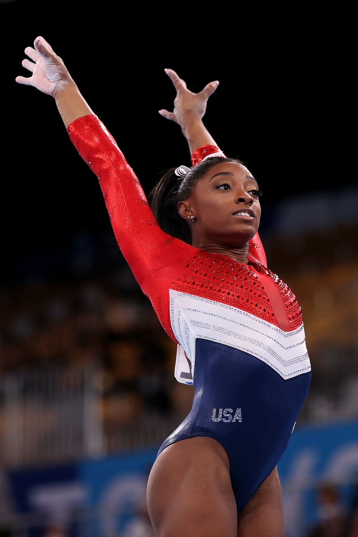 TOKYO, JAPAN - JULY 27: Simone Biles of Team United States competes in vault during the Women's Team Final on day four of the Tokyo 2020 Olympic Games at Ariake Gymnastics Centre on July 27, 2021 in Tokyo, Japan. (Photo by Laurence Griffiths/Getty Images)