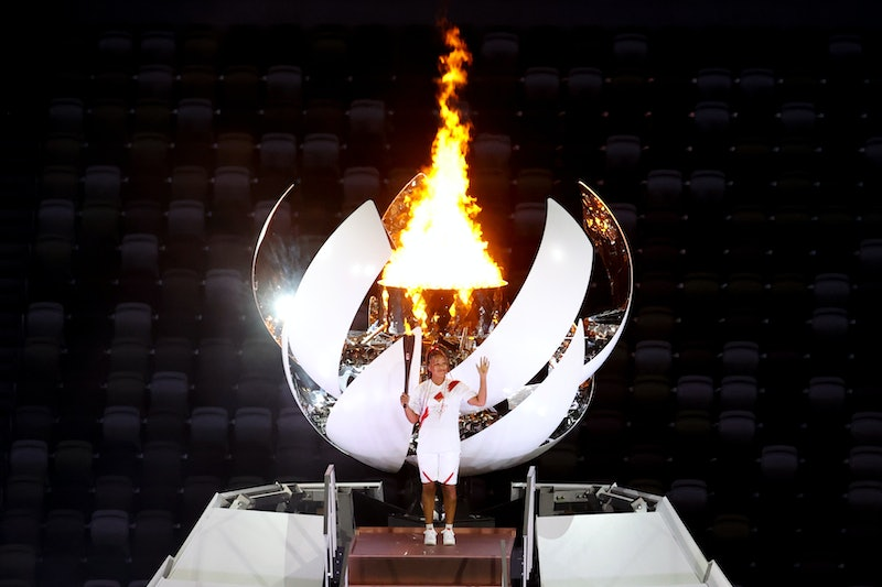Naomi Osaka of Japan stands with the Olympic flame during the Opening Ceremony of the Tokyo 2020 Oly...