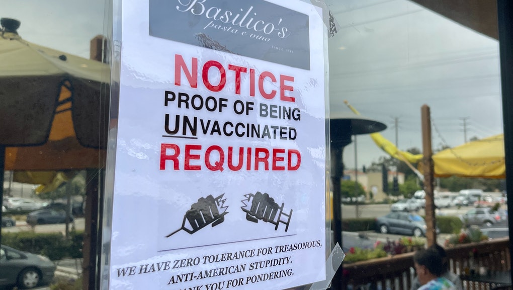 HUNTINGTON BEACH, CA - JULY 26: Signs at Basilicos Pasta e vino encourage people without the COVID-1...