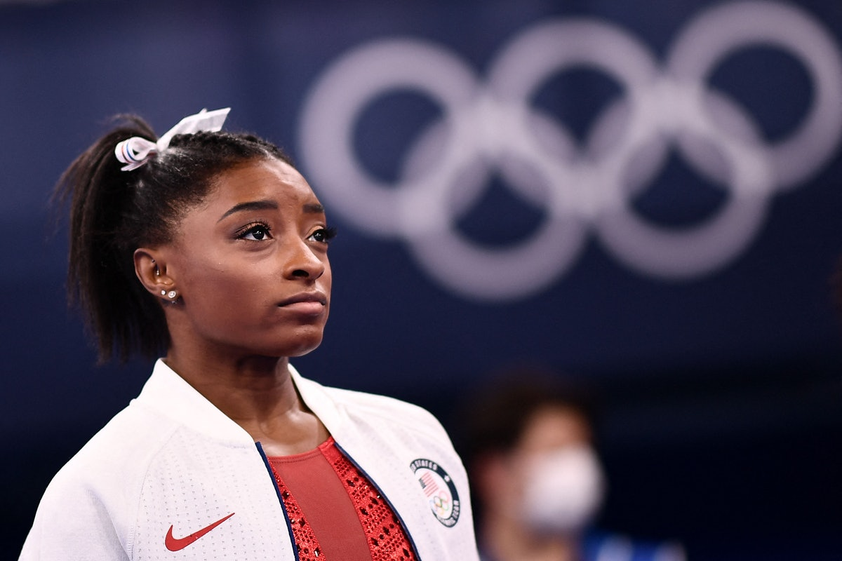 USA's Simone Biles looks on during the artistic gymnastics women's team final during the Tokyo 2020 Olympic Games at the Ariake Gymnastics Centre in Tokyo on July 27, 2021. (Photo by Loic VENANCE / AFP) (Photo by LOIC VENANCE/AFP via Getty Images)