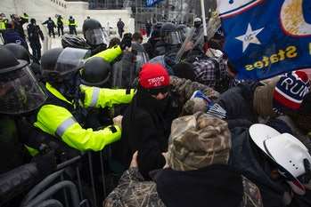 WASHINGTON, DC - JANUARY 06: Trump supporters clash with police and security forces as people try to...