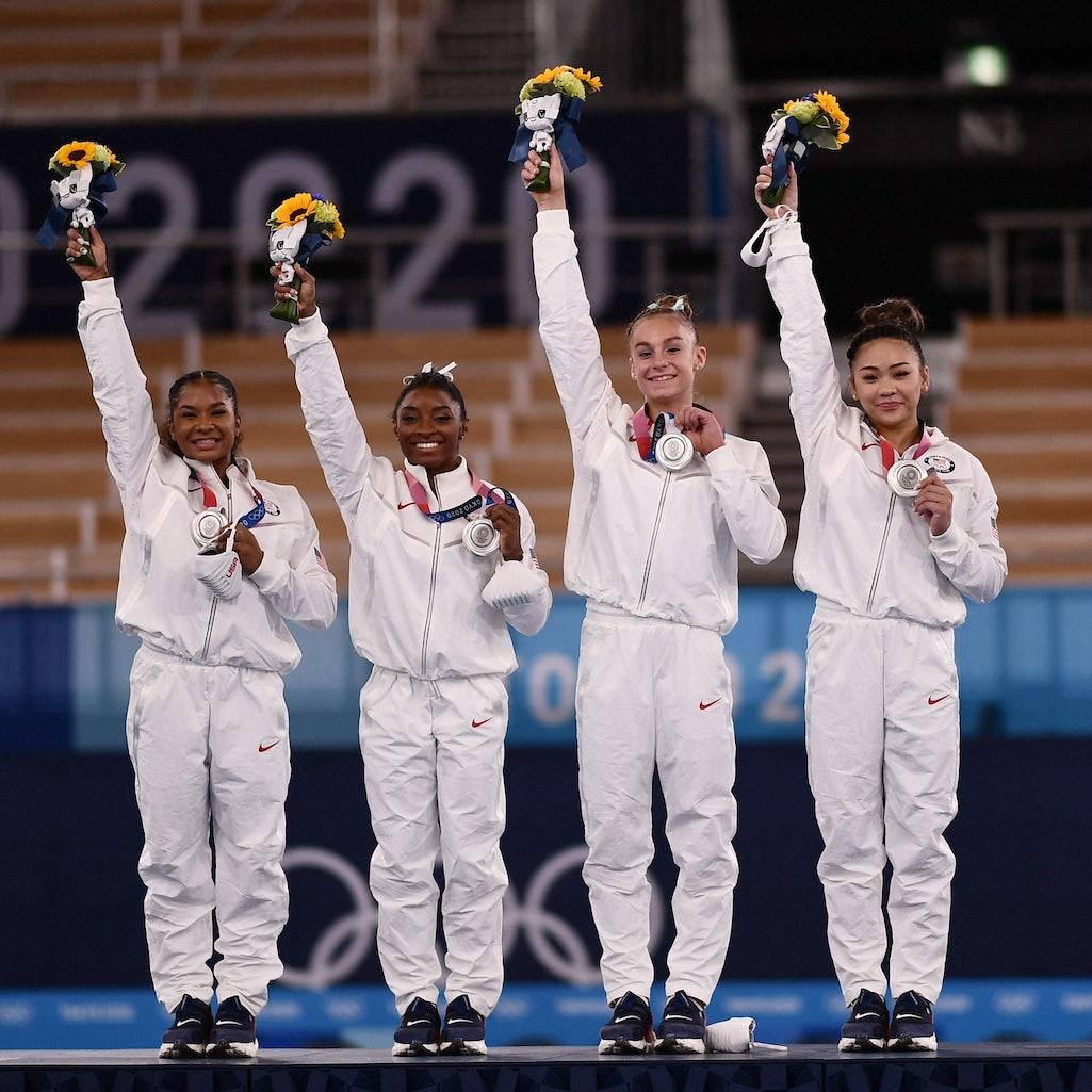 Silver medalists USA's Sunisa Lee, USA's Grace Mc Callum USA's Simone Biles and USA's Jordan Chiles ...