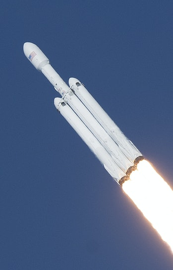 The SpaceX Falcon Heavy launches from Pad 39A at the Kennedy Space Center in Florida, on February 6, 2018, on its demonstration mission.  The world's most powerful rocket blasted off Tuesday on its highly anticipated maiden test flight. About two minutes into the flight, the side boosters peeled away from the center core and landed back on Earth. The third, center booster was to land on an ocean platform but its status is unclear.  / AFP PHOTO / Jim WATSON / ALTERNATIVE CROP         (Photo credit should read JIM WATSON/AFP via Getty Images)