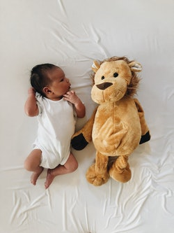 Portrait of a baby boy and his stuffed lion