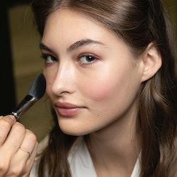 MILAN, ITALY - SEPTEMBER 19: Model Grace Elizabeth is seen backstage ahead of the Alberta Ferretti s...