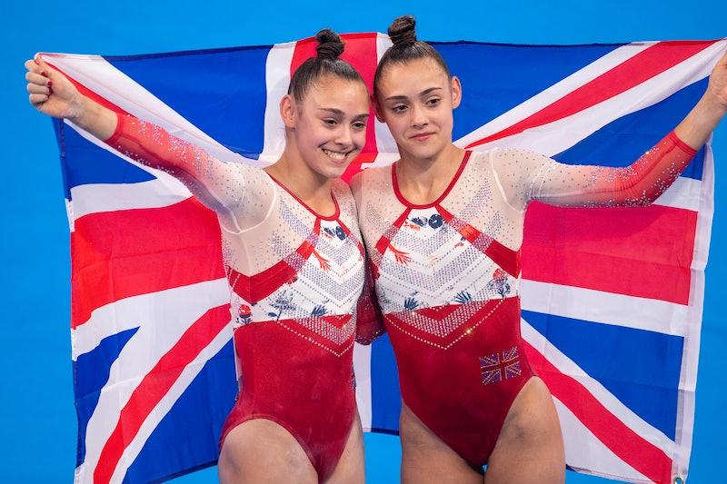 TOKYO, JAPAN - JULY 27: Twins Jennifer Gadirova and Jessica Gadirova of Great Britain after their te...