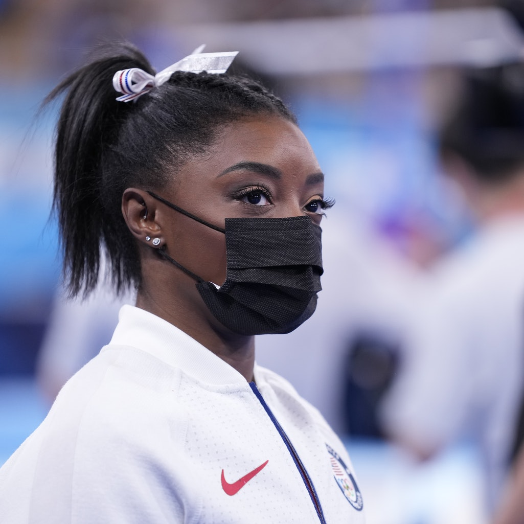 TOKYO, JAPAN - JULY 27: Simone Biles of Team United States looks on during the Women's Team Final on...