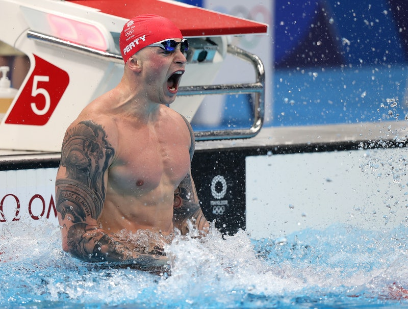 TOKYO, JAPAN - JULY 26: Adam Peaty of Team Great Britain reacts after winning the gold medal in the ...