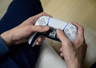 In a photo taken on November 12, 2020, a gamer plays on the new Sony Playstation PS5 at his home in ...