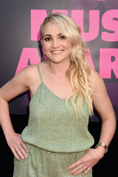 Jamie Lynn Spears wearing a green jumpsuit at a premiere.