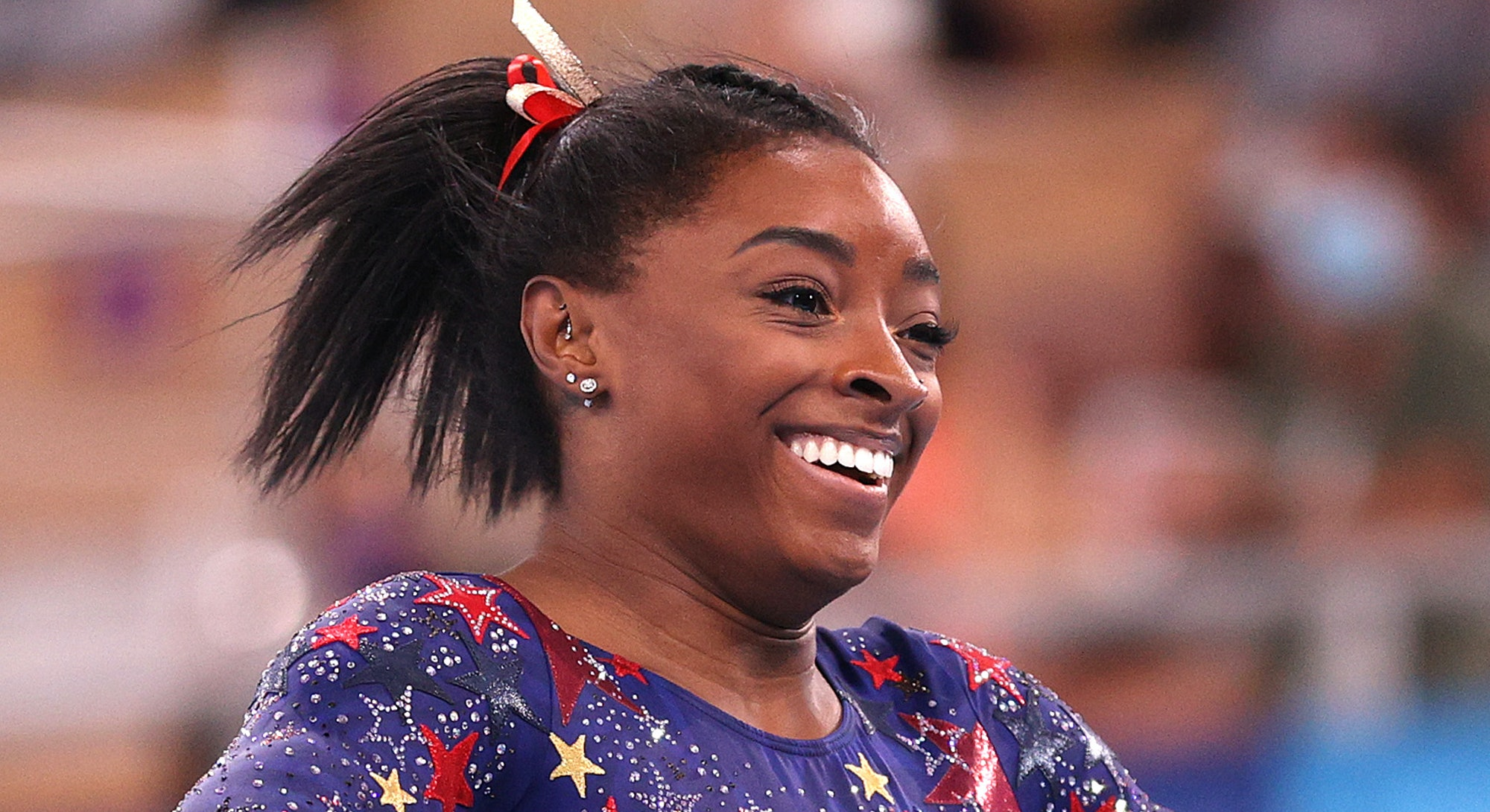 Simone Biles reacts after competing on balance beam during Women's Qualification on day two of the T...