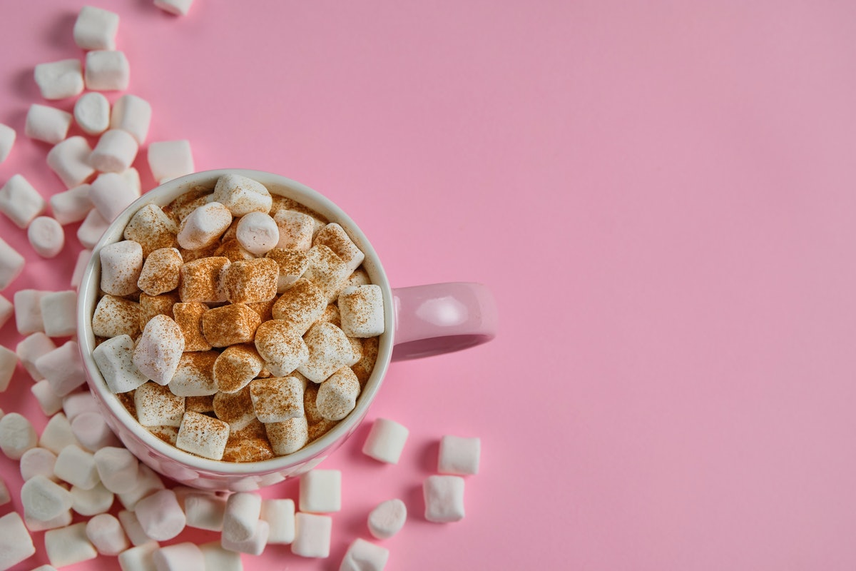 A cup of hot chocolate with marshmallows, which you might need captions for your Instagram.