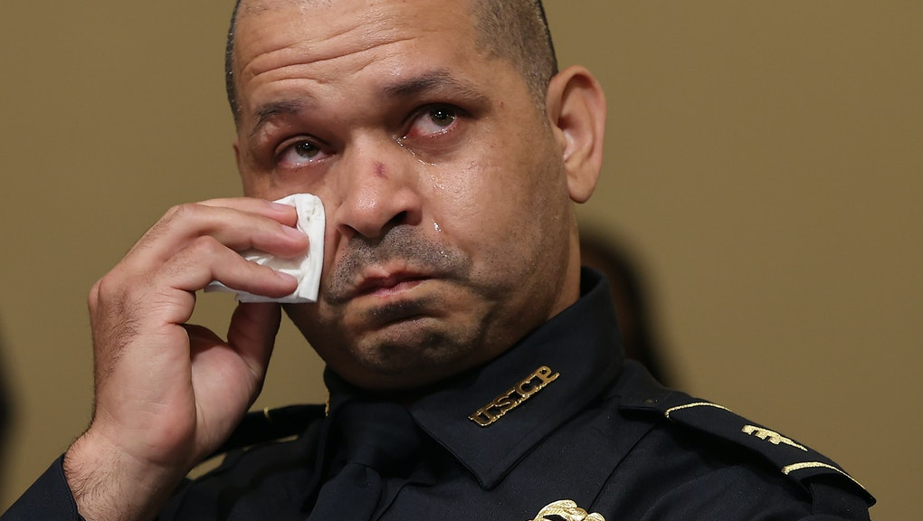WASHINGTON, DC - JULY 27: U.S. Capitol Police officer Sgt. Aquilino Gonell becomes emotional as he t...
