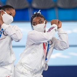 Simone Biles and Jordan Chiles of the United States bump hips at the Tokyo Olympics. Here's why gymn...