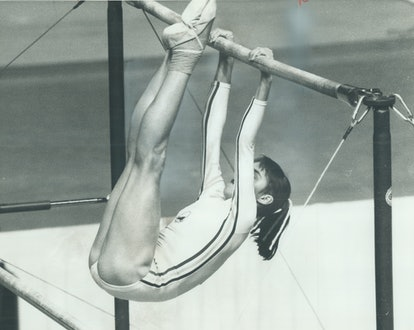 Romanian gymnast Nadia Comaneci on the parallel bars. Why are gymnasts so short?
