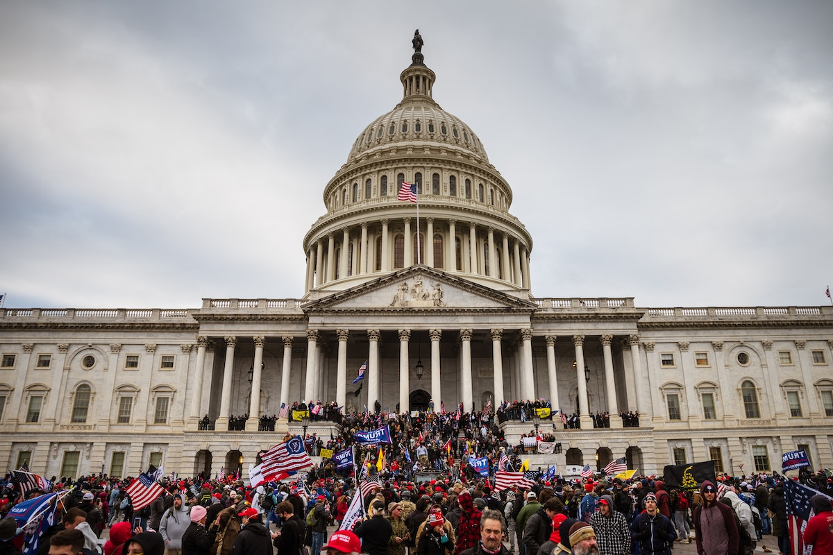 WASHINGTON, DC - JANUARY 06: A large group of pro-Trump protesters stand on the East steps of the Ca...
