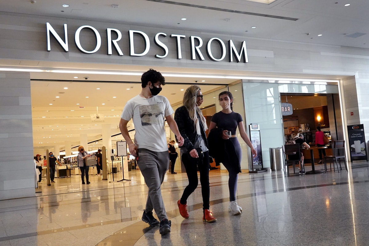 Shoppers leaving a Nordstrom, which is currently having the Nordstrom Anniversary Sale and discounting tons of beauty exclusives
