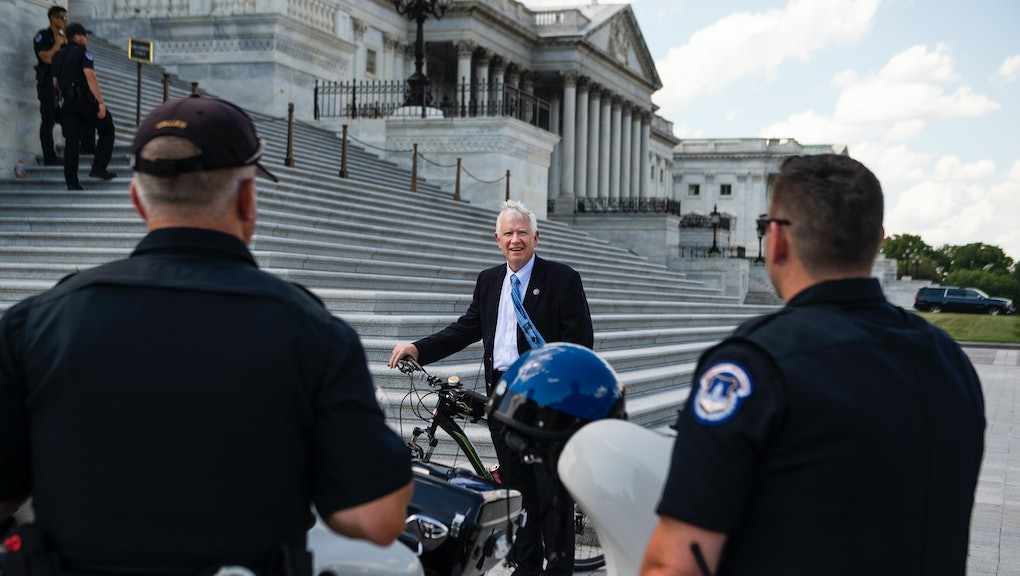 UNITED STATES - JUNE 30: Rep. Mo Brooks, R-Ala., talks with U.S. Capitol Police before a House vote ...