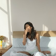A woman yawns after waking up. Always sleepy no matter how much sleep I get? Experts share why peopl...