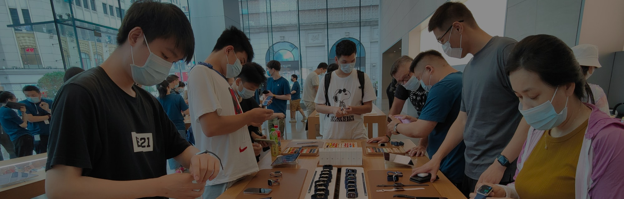 SHANGHAI, CHINA - JULY 2, 2021 - Consumers pick up a trial of Apple Watch Series 6 and Apple Watch S...