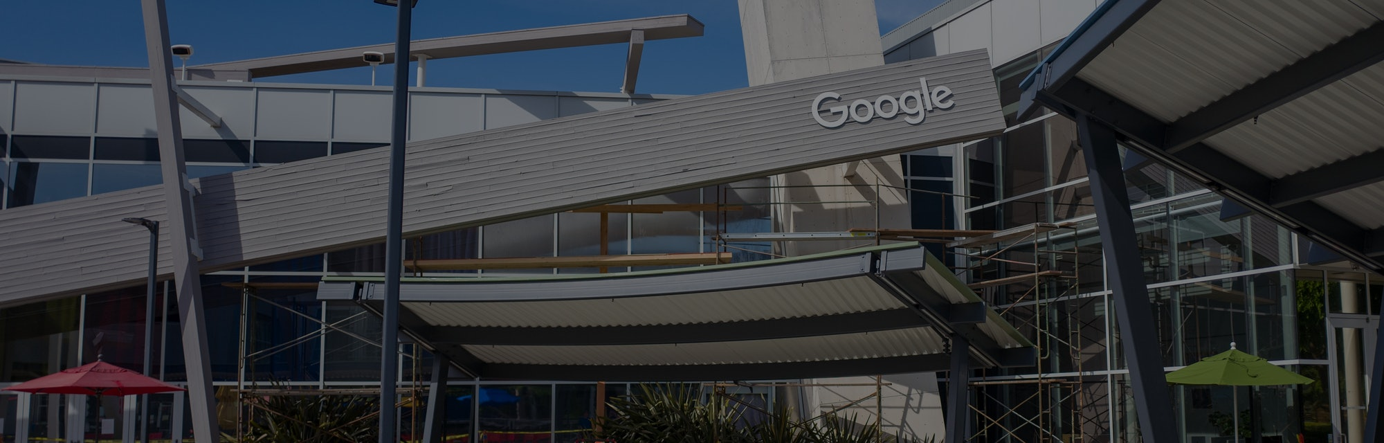 Facade with logo at the Googleplex, headquarters of Google Inc in the Silicon Valley, Mountain View,...