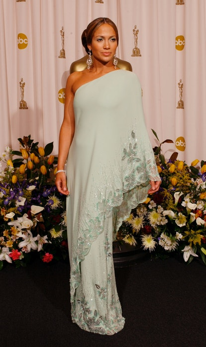 HOLLYWOOD - MARCH 23:  Actress Jennifer Lopez, wearing Harry Winston jewelry, poses during the 75th ...