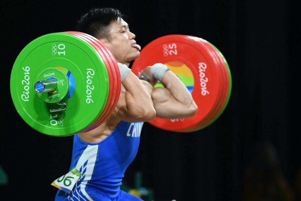RIO DE JANEIRO, BRAZIL - AUGUST 10: Lyu Xiaojun of China competes during the Men's 77kg weightlifti...