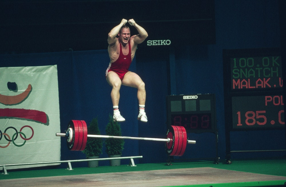Malak takes a jump after lifting at the 1992 Barcelona Olympic Games. | Location: Barcelona, Spain. ...