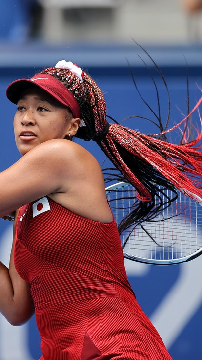 TOKYO, JAPAN - JULY 26: Naomi Osaka of Team Japan plays a backhand during her Women's Singles Second...