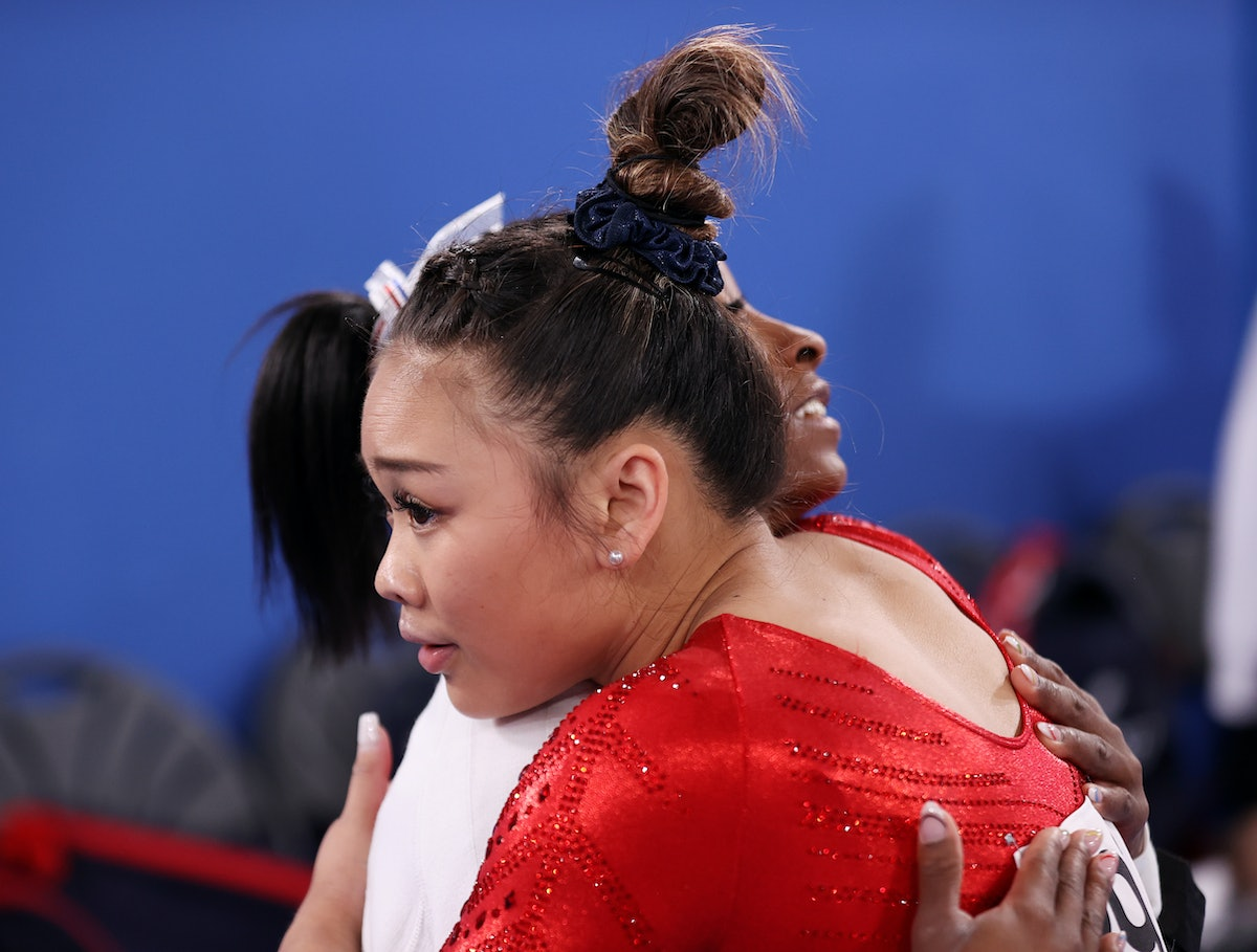 TOKYO, JAPAN - JULY 27: Sunisa Lee of Team United States is embraced by teammate Simone Biles during...