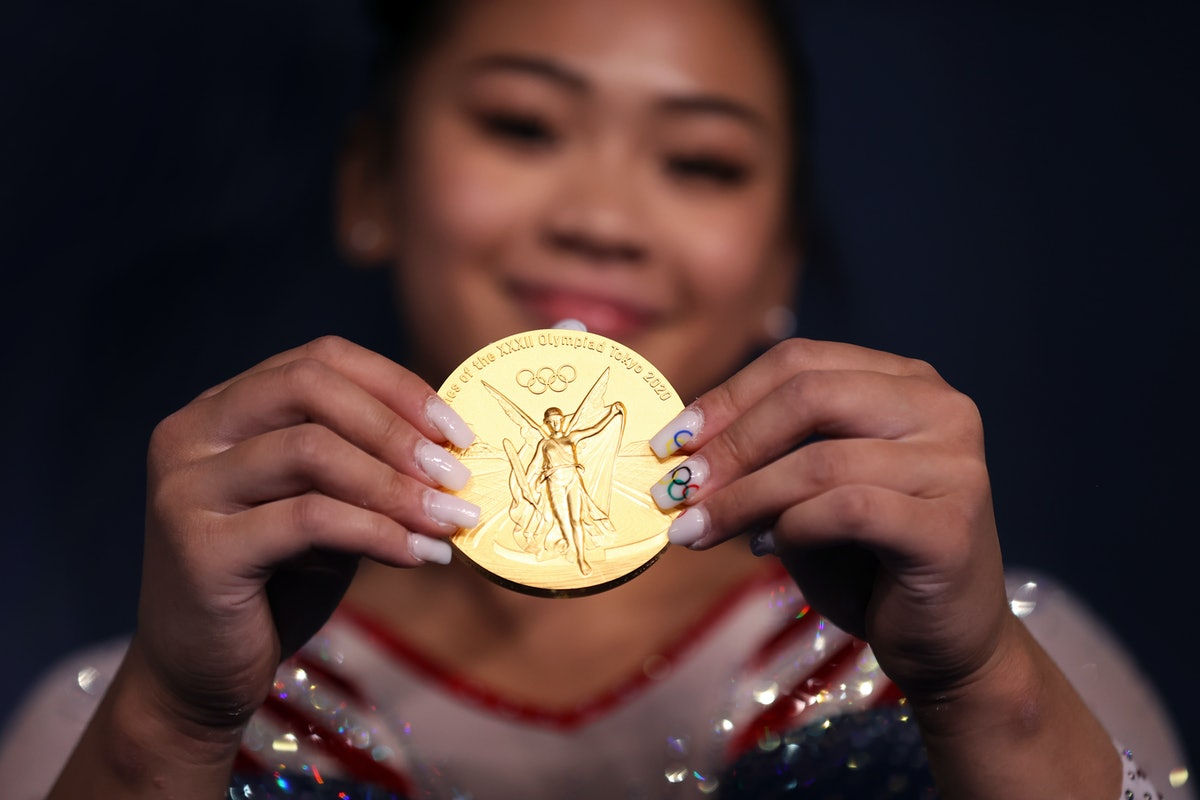 TOKYO, JAPAN - JULY 29: Sunisa Lee of Team United States poses with her gold medal after winning the...