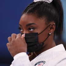 """Simone Biles of the United States after experiencing """"the twisties,"""" causing her to drop out of two ..."""