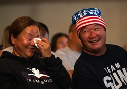 OAKDALE, MN - JULY 29: John Lee (R), Sunisa Lee's father, and Yeev Thoj react after Sunisa Lee of Te...