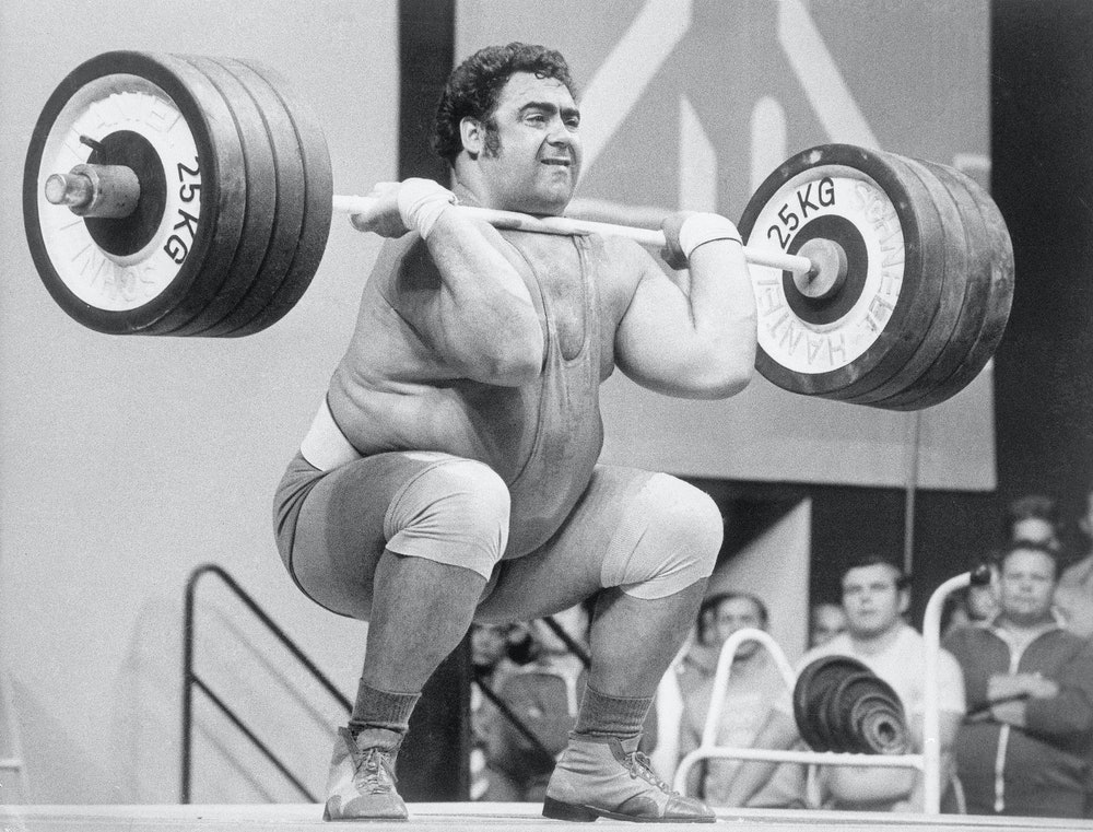 (Original Caption) 9/6/1972-Munich, Germany- Soviet Union's Vassili Alexeev sets a new Olympic world...