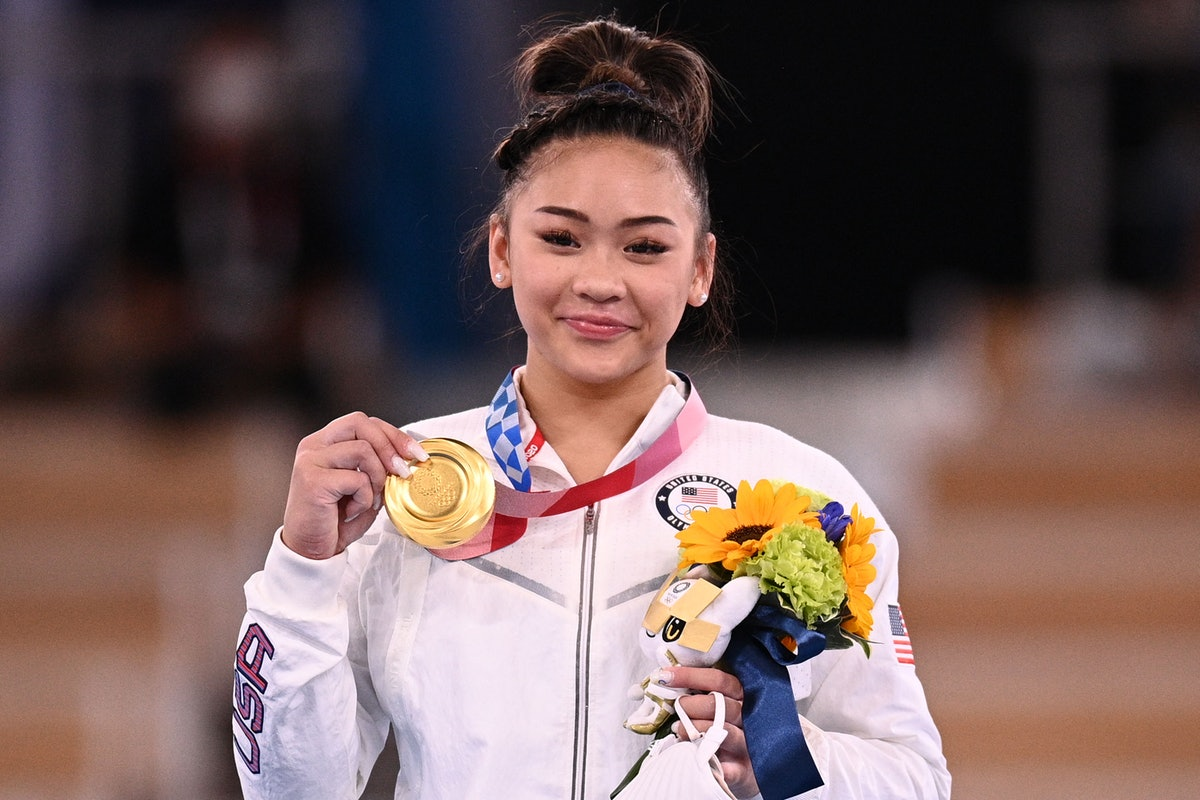 USA's Sunisa Lee poses with her gold medal during the podium ceremony of the artistic gymnastics wom...
