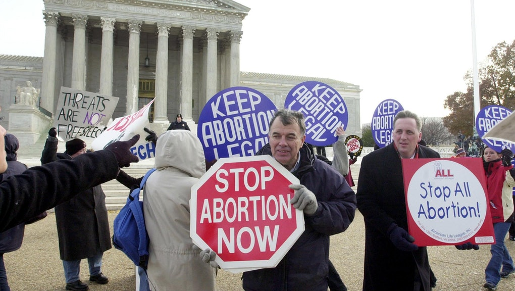 Both pro-choice and pro-life activists demonstrate in front of the US Supreme Court, 04 December, 20...
