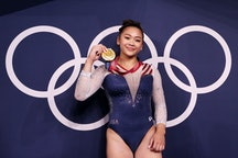 Suni Lee is now an Olympics champion. And there's a hidden message behind her Team USA gymnastics un...