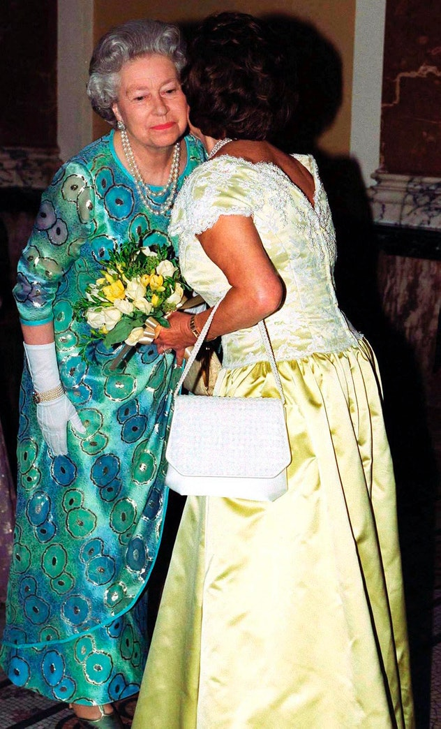 Princess Margaret kisses the cheek of the Queen.
