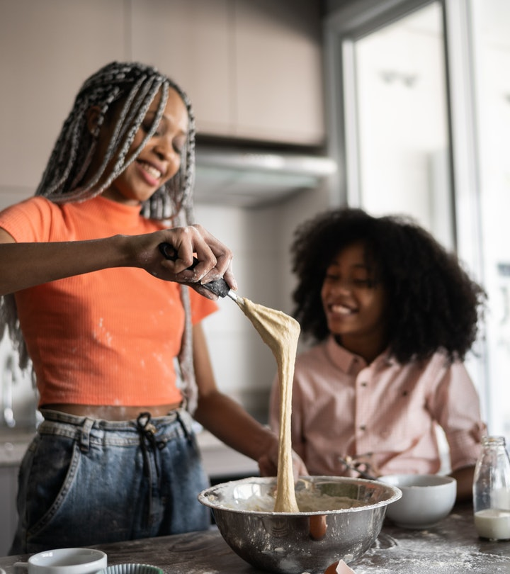 Sisters making a cake together at home