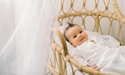 Cottagecore nurseries can include light fabrics and rattan cribs and cots.