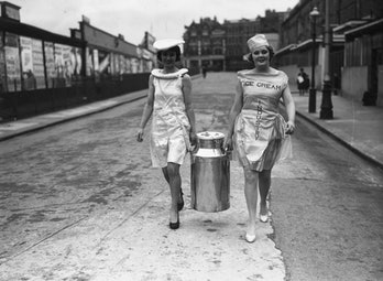 10th October 1938:  A churn of ice cream is carried into the Olympia Exhibition Centre in readiness ...
