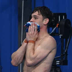 Britain's Thomas Daley waits with Britain's Matty Lee (unseen) to hear the result of the men's synch...