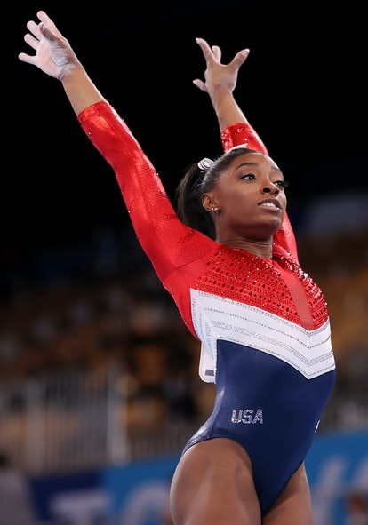 Simone Biles wearing a red, white, and blue leotard at the Olympics.