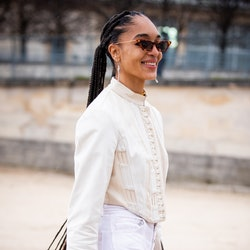 PARIS, FRANCE - FEBRUARY 25: Model Indira Scott, wearing a cream top and white pants,, is seen outsi...